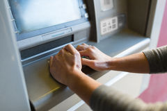 Close up of hand entering pin code at atm machine Royalty Free Stock Photo