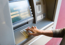 Close up of hand entering pin code at atm machine Royalty Free Stock Image