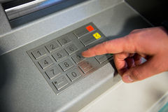 Close-up of hand entering PIN code on ATM machine keypad. Stock Photography