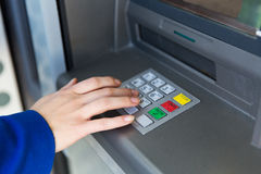 Close up of hand entering pin code at cash machine Royalty Free Stock Image