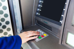 Close up of hand entering pin code at cash machine Stock Photography