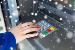 Close up of hand entering pin code at cash machine Stock Photos