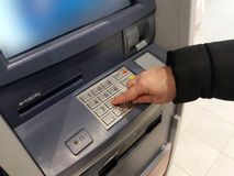 Close-up of hand entering PIN/pass code on ATM/bank machine keypad Stock Photo