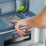 Close-up of hand entering PIN/pass code on ATM/bank machine keypad royalty free stock photography