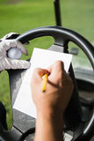 Close up of hand filling a piece of paper Royalty Free Stock Image