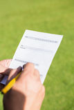 Close up of hand filling a piece of paper Royalty Free Stock Photo