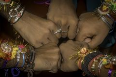 Close up hand fist of human boys friends waring friendship band on arms. Teamwork confident togetherness positivity expression cel. Ebration and spirit gesture stock photo
