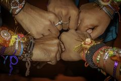 Close up hand fist of human boys friends waring friendship band. stock image