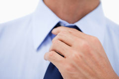 Close up of a hand fixing a tie Royalty Free Stock Images