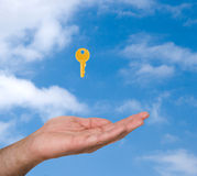 Close up of hand  and golden key Stock Photos