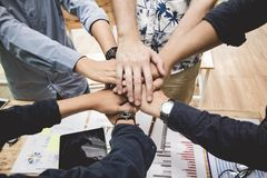 Close up ,Hand Group asia businessman together create a mutually beneficial business relationship. Economic graph on the table. stock photo