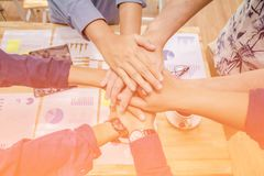 Close up ,Hand Group asian businessman together create a mutually beneficial business relationship. Economic graph on the table,St royalty free stock photography