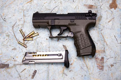 Overview of pistol and ammo. Royalty Free Stock Photo