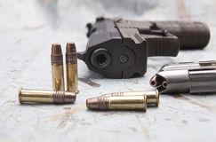 Bullets and a pistol. Stock Image