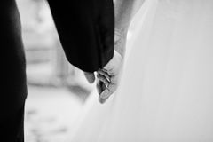 Close up hand in hand of wedding couple. Black and white photo Royalty Free Stock Photography