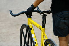 Close up hand hold bicycle handle Royalty Free Stock Images