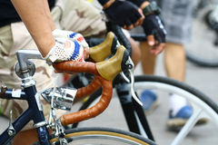 Close up hand hold bicycle handle Royalty Free Stock Image