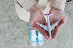Close up hand holding an airplane model Royalty Free Stock Photo