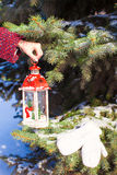 Close up of a hand holding beautiful vintage Christmas lantern Royalty Free Stock Photography