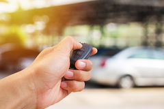 Close up hand holding car key Royalty Free Stock Image