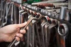 Hand holding a car mechanic tool. Royalty Free Stock Image