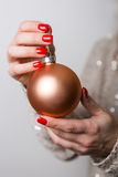 Close up hand holding Christmas ball Royalty Free Stock Image