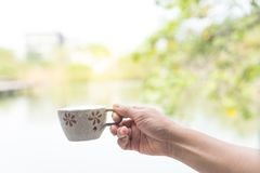 Close up hand holding coffee cup. stock image