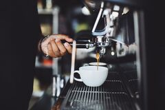 Close-up of Hand Holding Coffee Machine Royalty Free Stock Photos