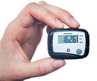 Close-up Of Hand  Holding Digital Pedometer On Stock Images