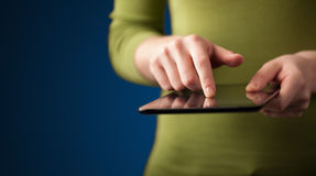 Close up of hand holding digital touchpad tablet device Stock Photography