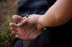 Close up of hand holding foot in yoga Stock Photo