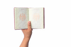 Close up hand holding German passport isolated on white Stock Images