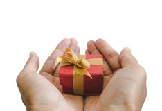 Close-up hand holding, giving or receiving gift box, isolated on white background Stock Image
