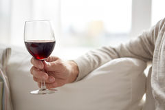 Close up of hand holding glass with red wine Royalty Free Stock Photos