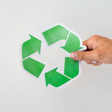 Close up of hand holding green recycle symbol Royalty Free Stock Photo