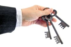 Real estate agent handing over house keys over white background royalty free stock image