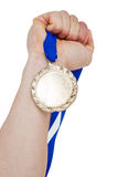 Close-up of hand holding olympic gold medal Royalty Free Stock Photo