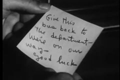 Close-up of hand holding paper with message written on it stock video