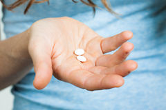 Close-up of hand holding pills Royalty Free Stock Image