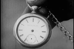 Close-up of hand holding pocket watch stock footage