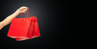 Close up of hand holding red shopping bags Stock Photography