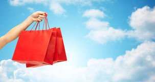 Close up of hand holding red shopping bags Royalty Free Stock Photography