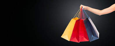 Close up of hand holding shopping bags Stock Photography