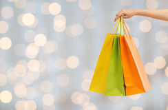 Close up of hand holding shopping bags Royalty Free Stock Image