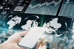 Trade and finance concept. Close up of hand holding smartphone on blurry night city background with digital business interface. Trade and finance concept. Double royalty free stock photos