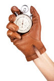 Close Up Of Hand Holding Stopwatch On White Background Stock Photography