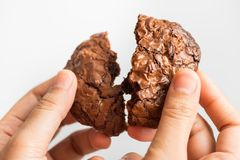 Close up hand holding sweet cookies chocolate brownie Stock Photo