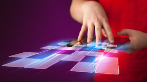 Close up of hand holding tablet with cyber application Stock Photo