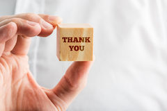 Close Up of Hand Holding Thank You Block Royalty Free Stock Photo