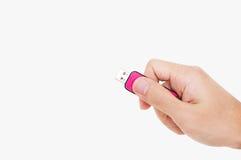 Close-up Hand holding USB data storage flash drive, isolated on white background Stock Photos